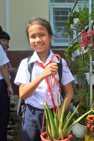 """I choose aloe vera, because its leaves are used as a medicine to heal the damaged skin, so I can help my friends when they are injured"", said My Tien – class 6B1, An Nhon Secondary School, Go Vap District, Ho Chi Minh City. Photo credit: An Ha Nguyen"