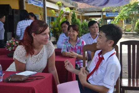 Emily enjoys the conversation with Quoc Huy, grade 8
